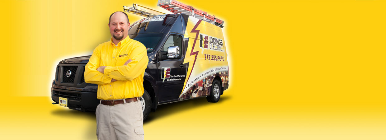 An Iddings electrician in front of his truck.